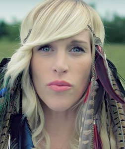 "A video still of Sarah Blackwood in Walk Off The Earth's visual for their tune ""Home We'll Go (Take My Hand)"" featuring Steve Aoki."